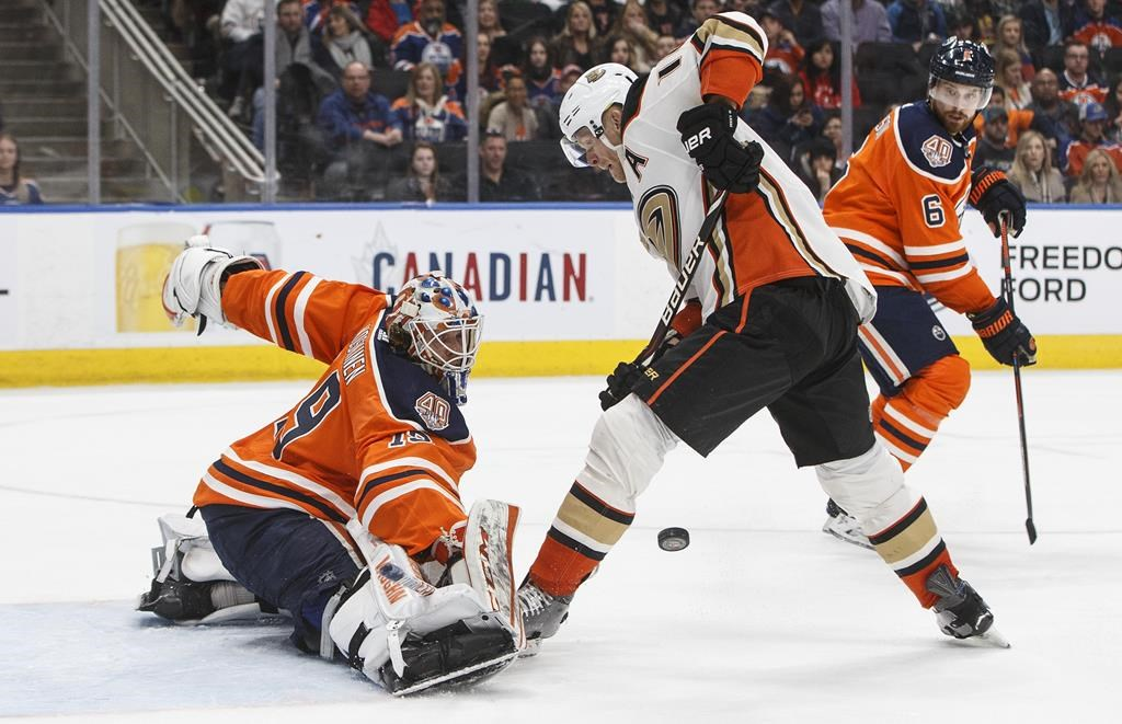 Anaheim Ducks' Corey Perry (10) is stopped by Edmonton Oilers' goalie Mikko Koskinen (19) during third period NHL action in Edmonton, Alta., on Saturday February 23, 2019. THE CANADIAN PRESS/Jason Franson.