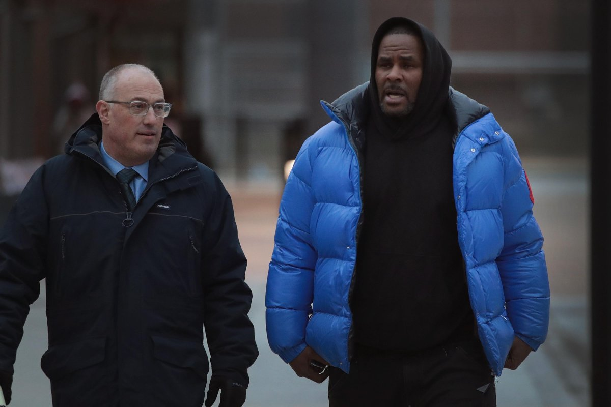R&B singer R. Kelly (R) and his attorney Steve Greenberg leave Cook County jail after Kelly posted $100 thousand bond on February 25, 2019 in Chicago, Illinois.  Kelly was being held after turning himself in to face ten counts of aggravated sexual abuse.  (Photo by ).