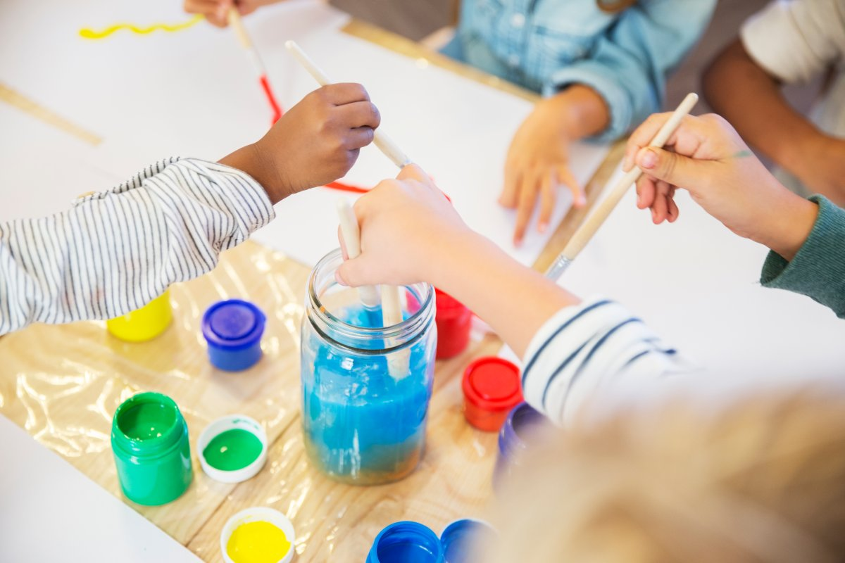 Students painting in a daycare facility. Test results show that one out of four Ontario schools and daycares that reported sampling data have found at least one tap water sample with lead levels exceeding federal guidelines.