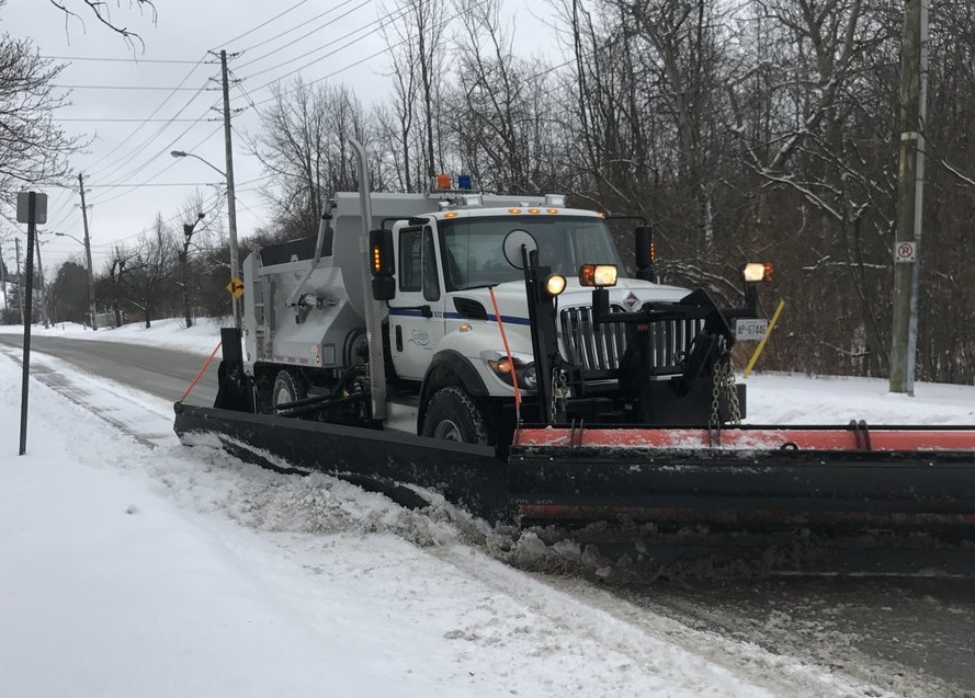 A Guelph snow plow cleans city streets.