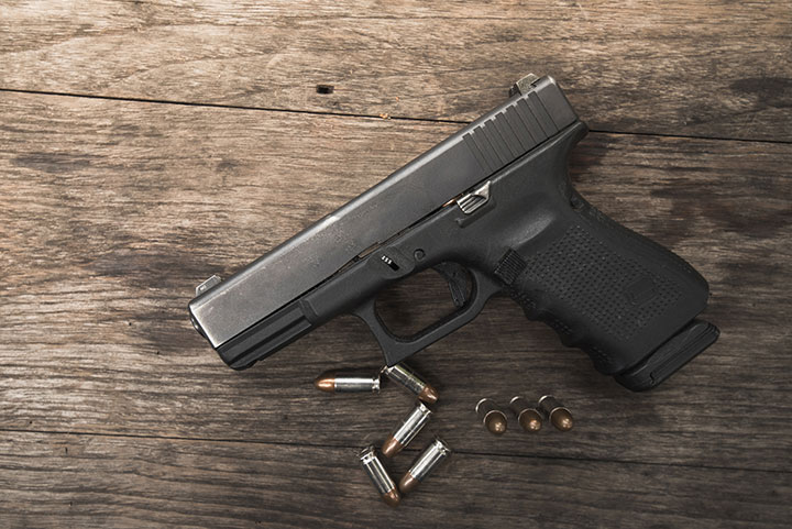A Texas man was rushed to hospital after he accidentally shot himself in the stomach while spinning a gun on his finger at his daughter's birthday party.
