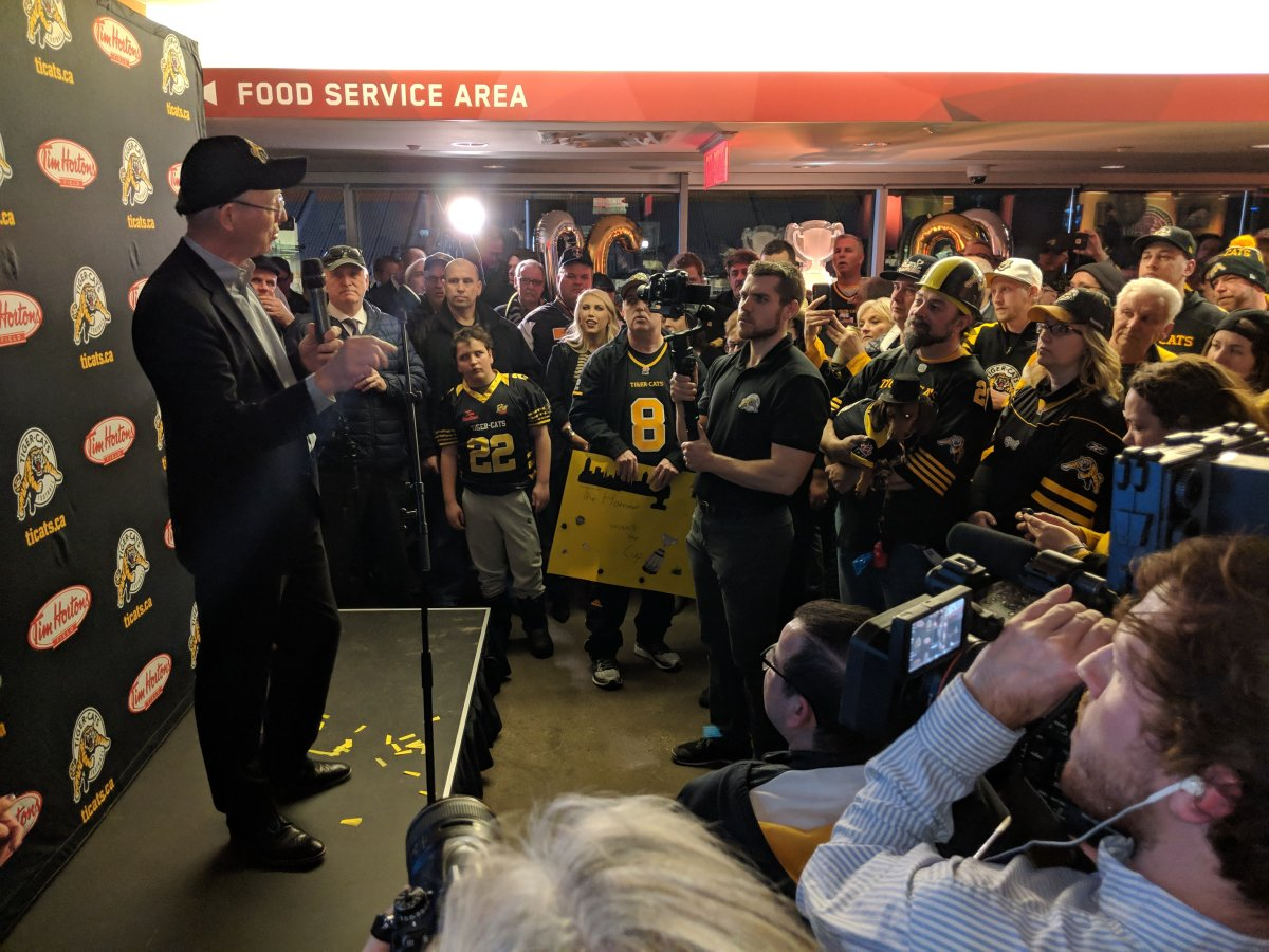 Fans gather to listen to Tiger-Cats owner Bob Young on the club level of Tim Hortons Field during a Tiger-Cats-hosted viewing party after the Canadian Football League announced that the 2021 Grey Cup will be hosted by Hamilton.