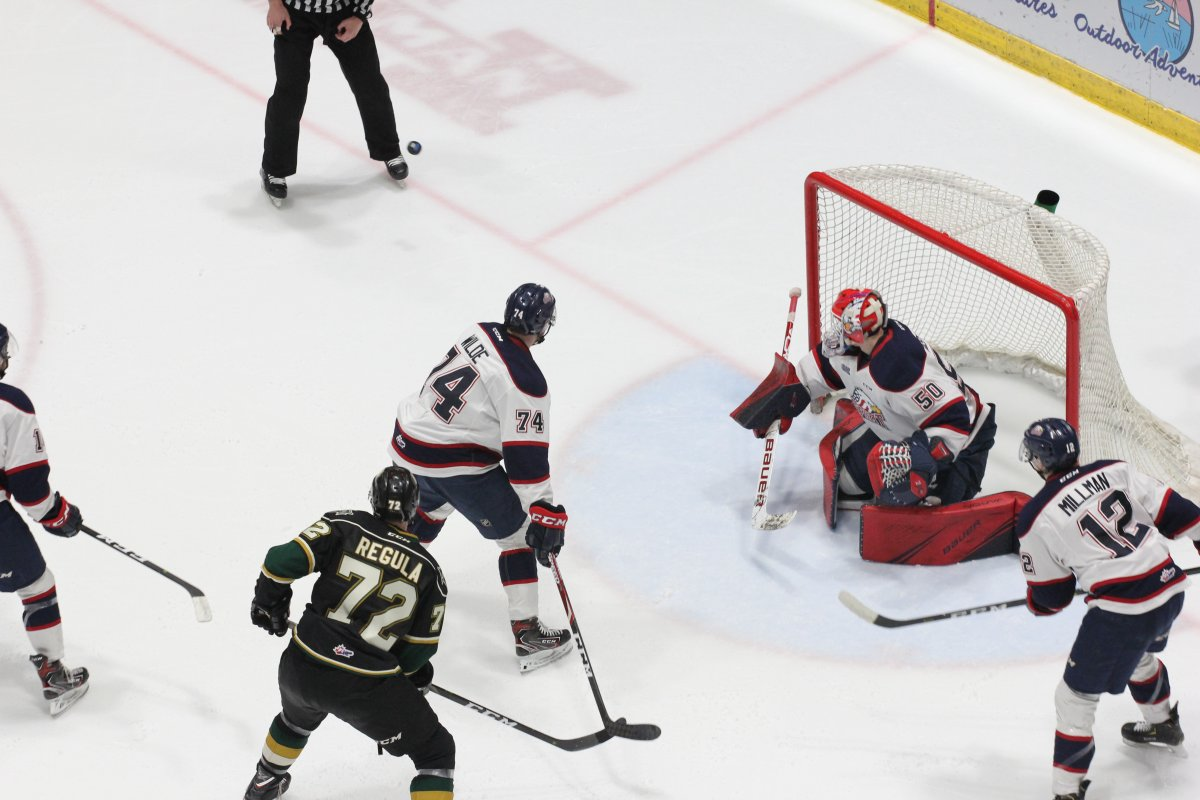 Saginaw, Mich. - Ivan Prosvetov makes one of his 55 saves in a 6-3 win over the London Knights on February 9, 2019.