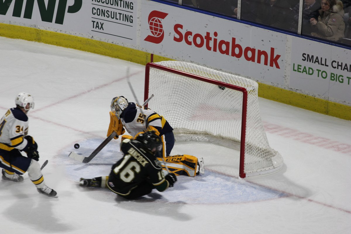 London, Ont. - Kevin Hancock of the London Knights gets stopped on the doorstep by Cole Ceci of Erie in a 4-3 overtime win by the Otters at Budweiser Gardens on February 15, 2019.