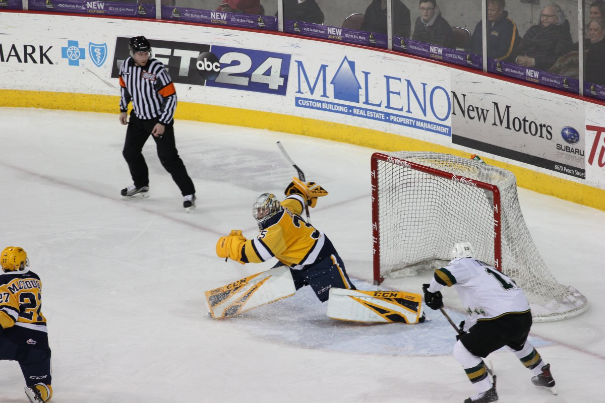Erie, PA - Cole Tymkin of the London Knights slides his 20th goal of the season into the Erie Otters' net in an 8-3 London win on February 17, 2019.