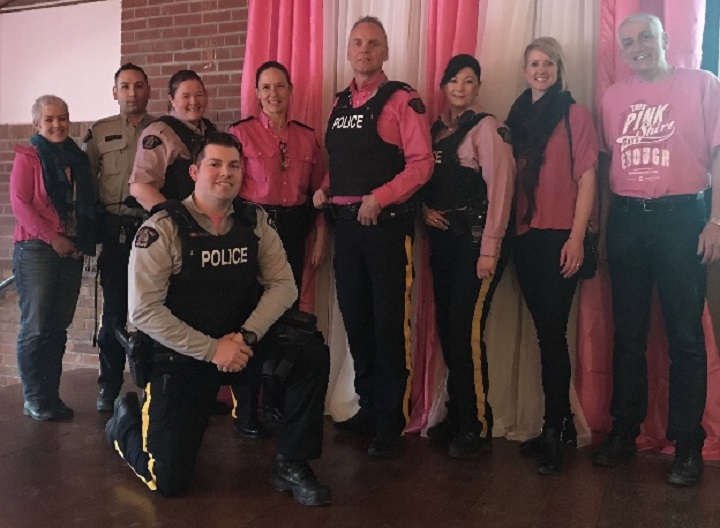 Members of the Kelowna RCMP gather for a photo during Pink Shirt Day on Wednesday.