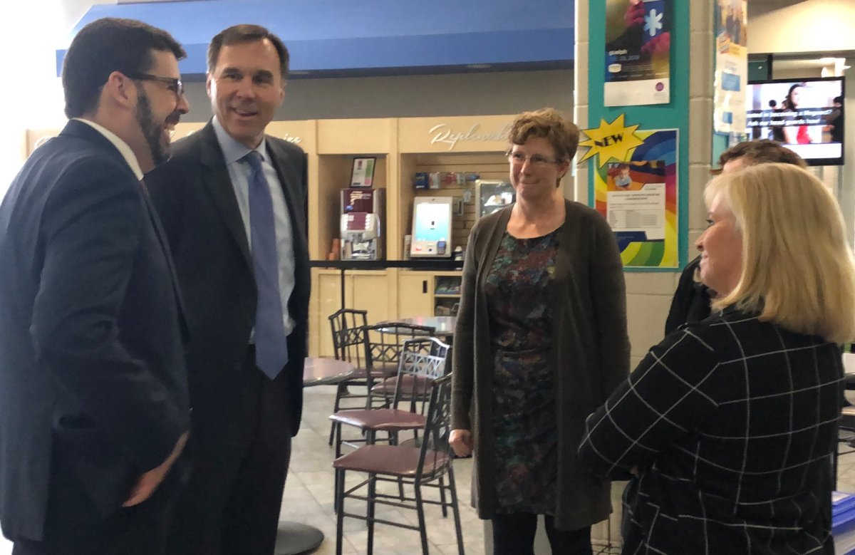 Federal Finance Minister Bill Morneau speaks with officials at the Guelph YMCA on Thursday.