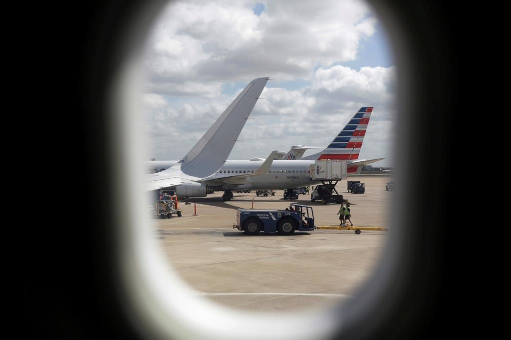 """FILE- In this June 16, 2018, file photo, American Airlines aircrafts aircrafts are seen at O""""Hare International Airport in Chicago."""