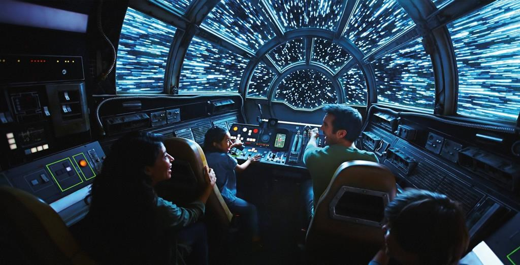 This rendering released by Disney and Lucasfilm shows people on the planned Inside Millennium Falcon: Smugglers Run attraction, part of Star Wars: Galaxy's Edge, a 14-acre area set to open this summer at the Disneyland Resort in Anaheim, Calif.