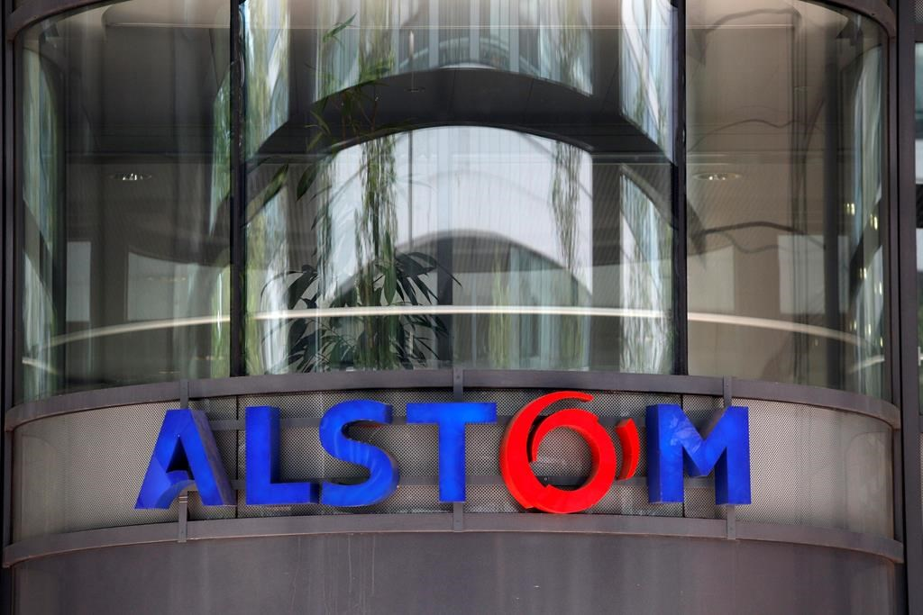FILE - This Wednesday, April 30, 2014, file photo shows the company logo of Alstom at their headquarters in Levallois-Perret, outside Paris, France. France's finance minister Bruno Le Maire says Wednesday Feb.6, 2019 that EU authorities have decided to reject a merger between France's Alstom and Germany's Siemens railway activities. (AP Photo/Christophe Ena, FILE).