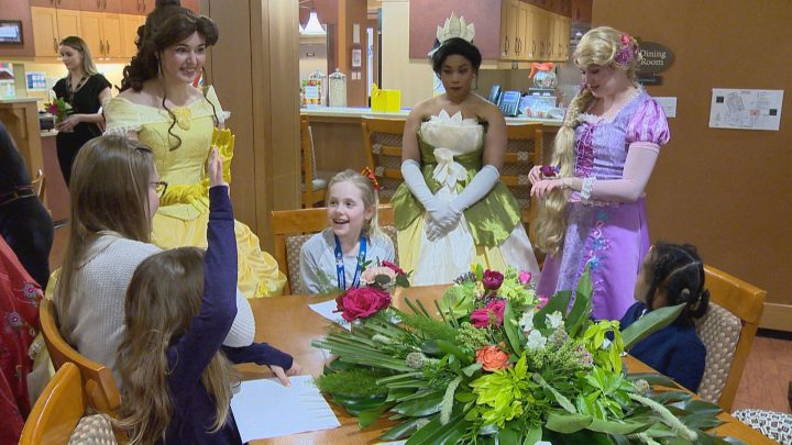Disney princesses and Spider-Man stopped by Ronald McDonald House Southern Alberta with flower arrangements on Monday.