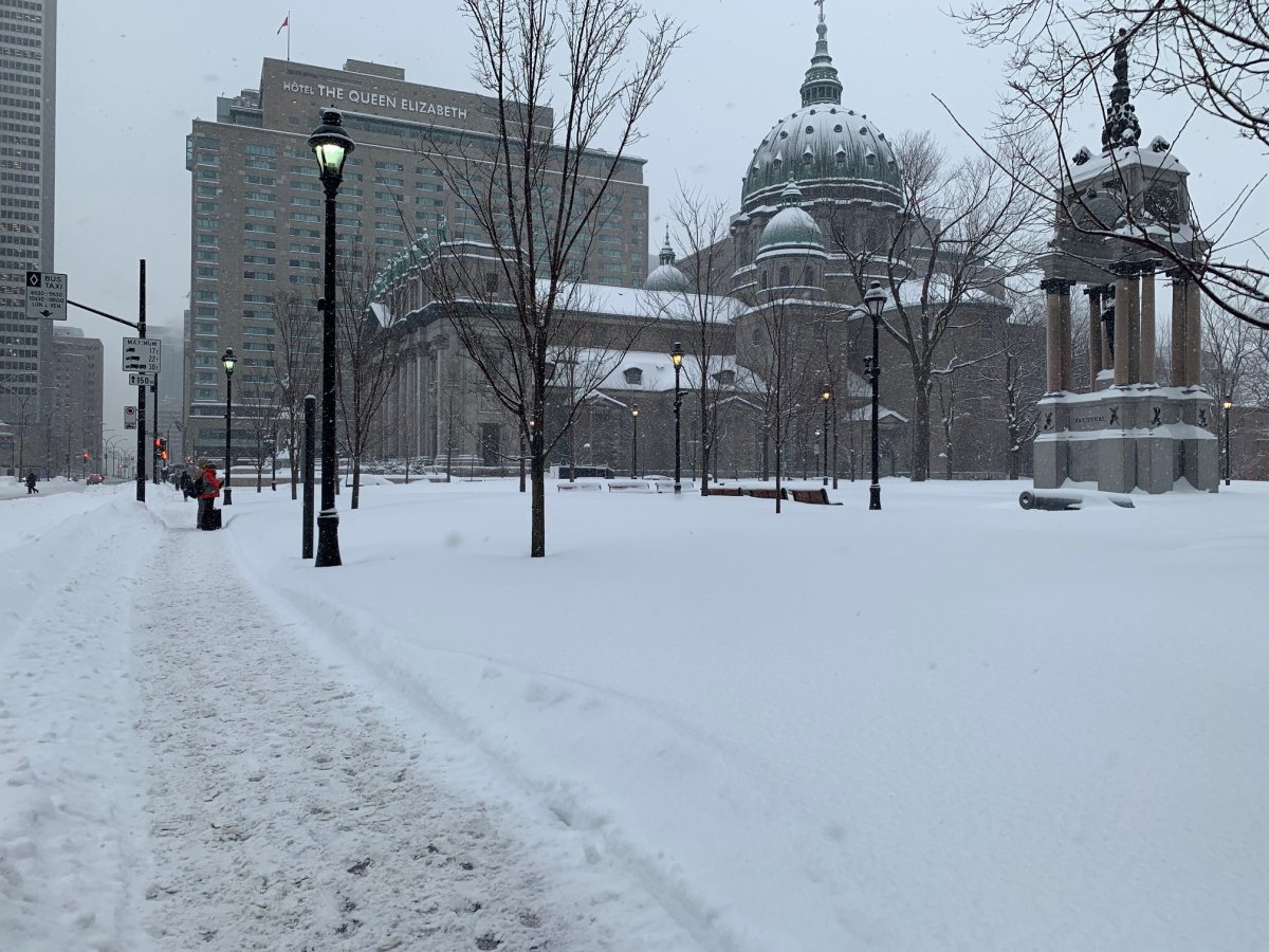 Snow covers the streets of Montreal after a winter storm, Wednesday., Feb. 13, 2019.
