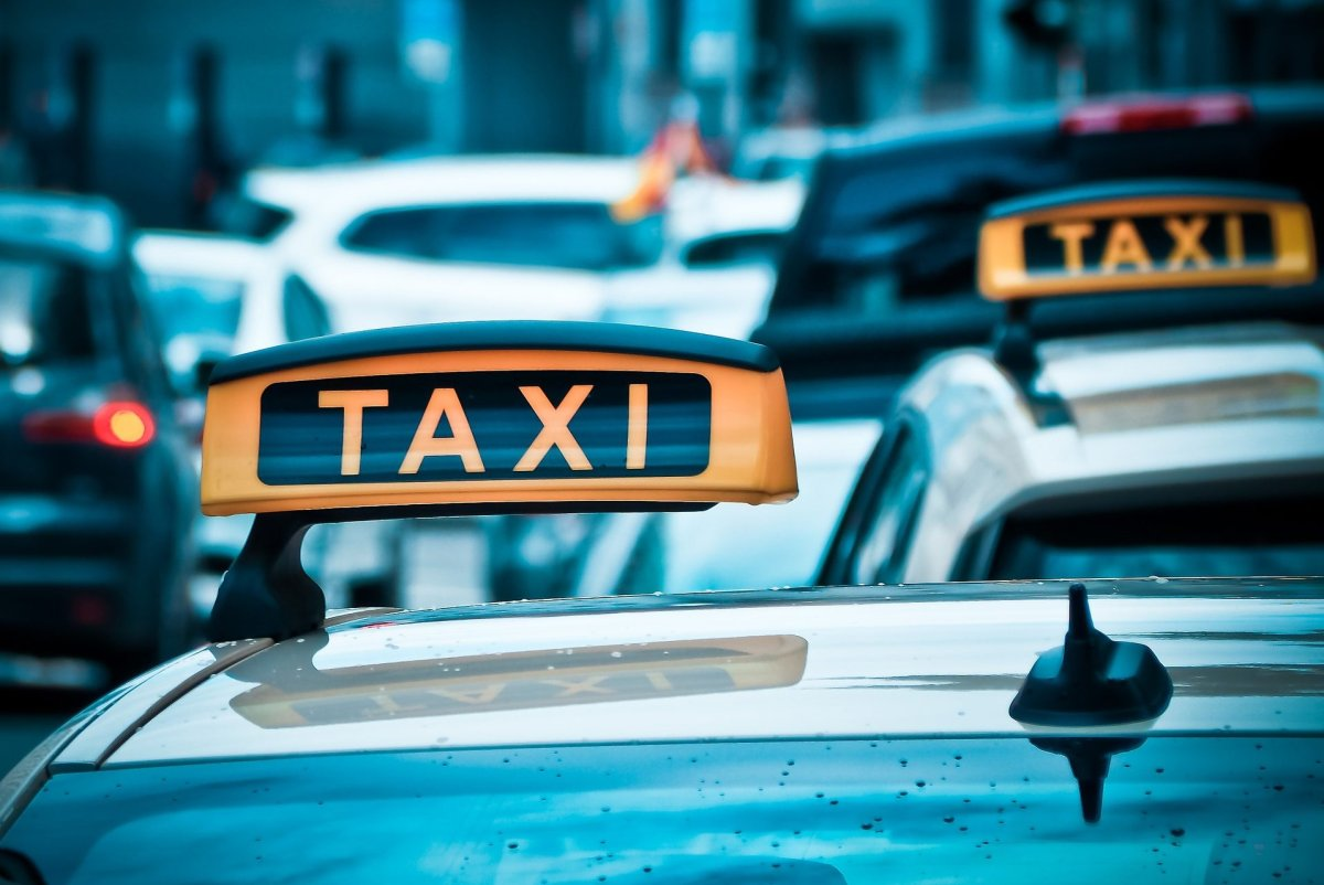 Taxi cabs on a street.