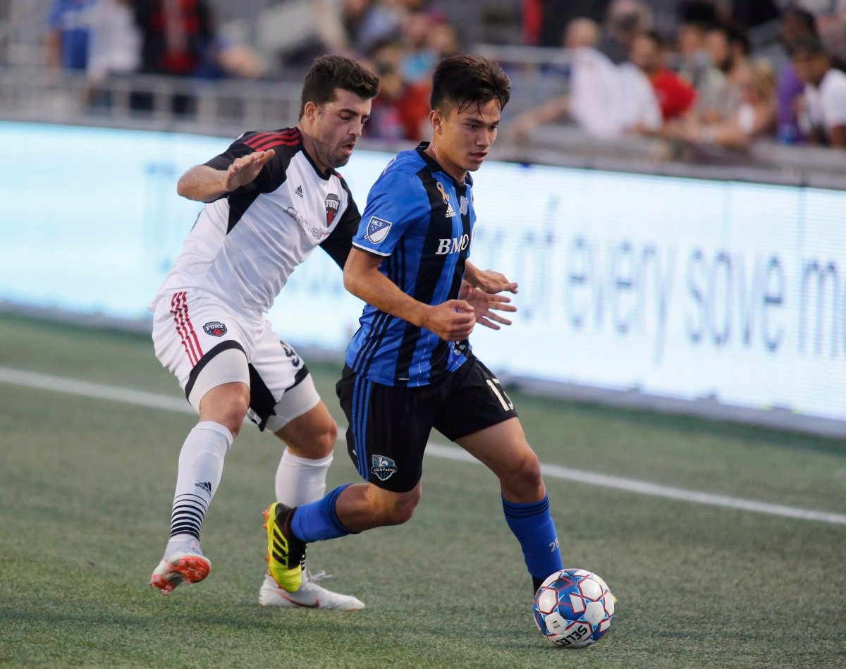 Montreal Impact Ken Krolicki (13) tries to keep the ball from Ottawa Fury FC Thiago de Freitas (93) during first half exhibition game soccer action in Ottawa on Friday, September 7, 2018.