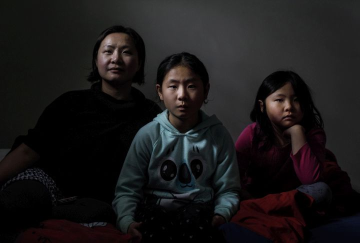 Vicki Maruyama and her daughters Akari Maruyama, centre and Arisa Maruyama, right, pictured in Edmonton on Wednesday, February 20, 2019. Maruyama says she feels like she's not Canadian enough after her daughters were denied citizenship.