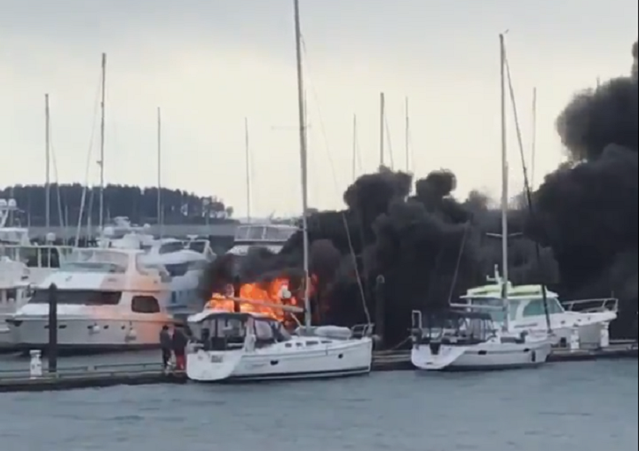 A yacht burns in the Port Sidney Marina on Saturday.