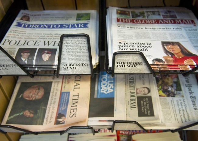 Stacks of The Globe and Mail and the Toronto Star sit in a news stand in Toronto on April 26, 2012.