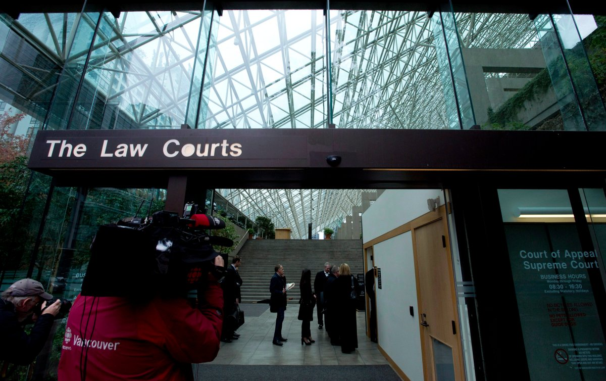 People line up to be screened to enter the British Columbia Supreme Court  in 2013 for the trial of the 2007 Surrey mass murder that left six dead.