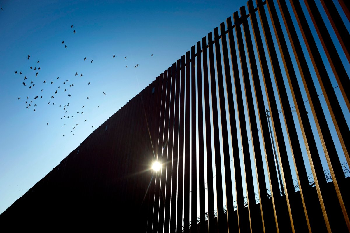 Birds fly over a section of the recently renovated US-Mexico border wall, in Calexico, California, USA, on 26 October 2018.