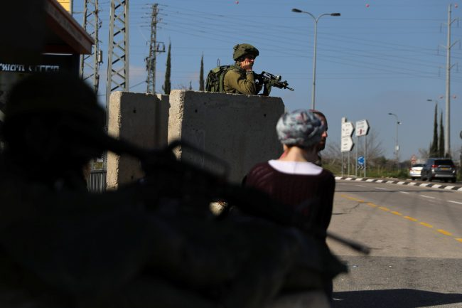 An Israeli soldier guards near the scene of Sunday's attack near the Jewish settlement of Ariel, in the Israeli-occupied West Bank March 18, 2019.