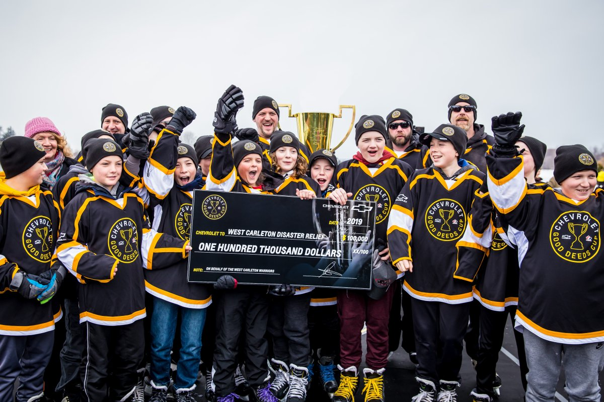 The West Carleton Warriors peewee hockey team celebrates after winning Chevrolet's Good Deeds Cup and a $100,000 grand prize, which will go towards tornado relief efforts in Ottawa's rural west end.