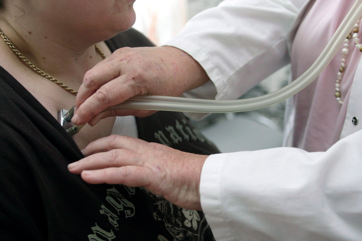 A doctor checks a patient with a stethoscope. (File photo).