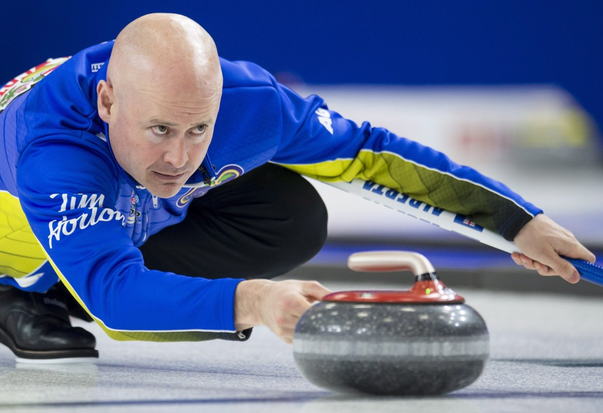 Team Alberta skip Kevin Koe makes a shot during the 16th draw against team wild-card at the Brier in Brandon, Man., Thursday, March, 7, 2019.