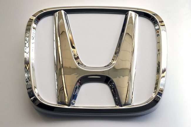 In this Feb. 14, 2019, photo, the Honda logo is seen on a sign at the 2019 Pittsburgh International Auto Show in Pittsburgh.