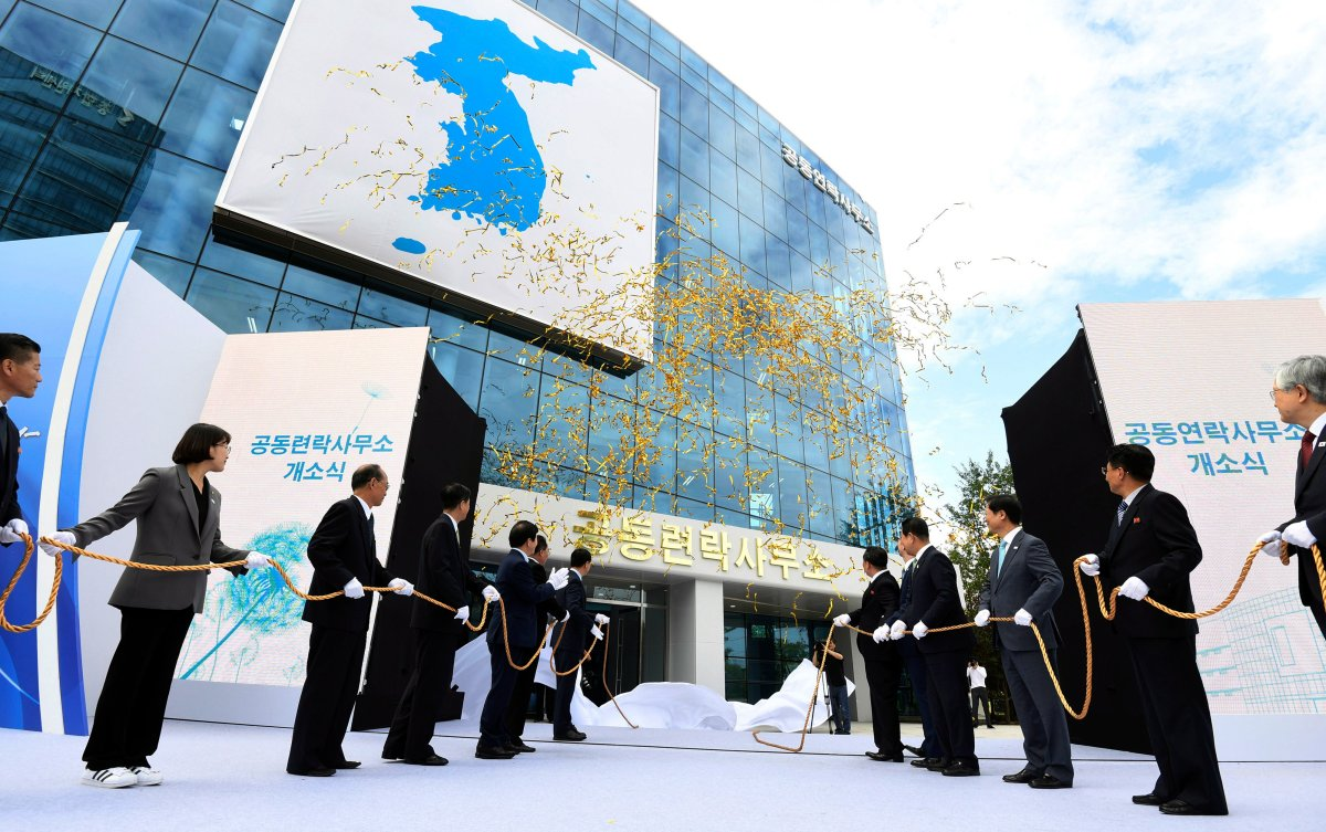 In this Sept. 14, 2018, file photo, South Korea's Unification Minister Cho Myoung-gyon, center left, and Ri Son Gwon, chairman of the North's Committee for the Peaceful Reunification, center right, attend at an opening ceremony for two Koreas' first liaison office in Kaesong, North Korea.