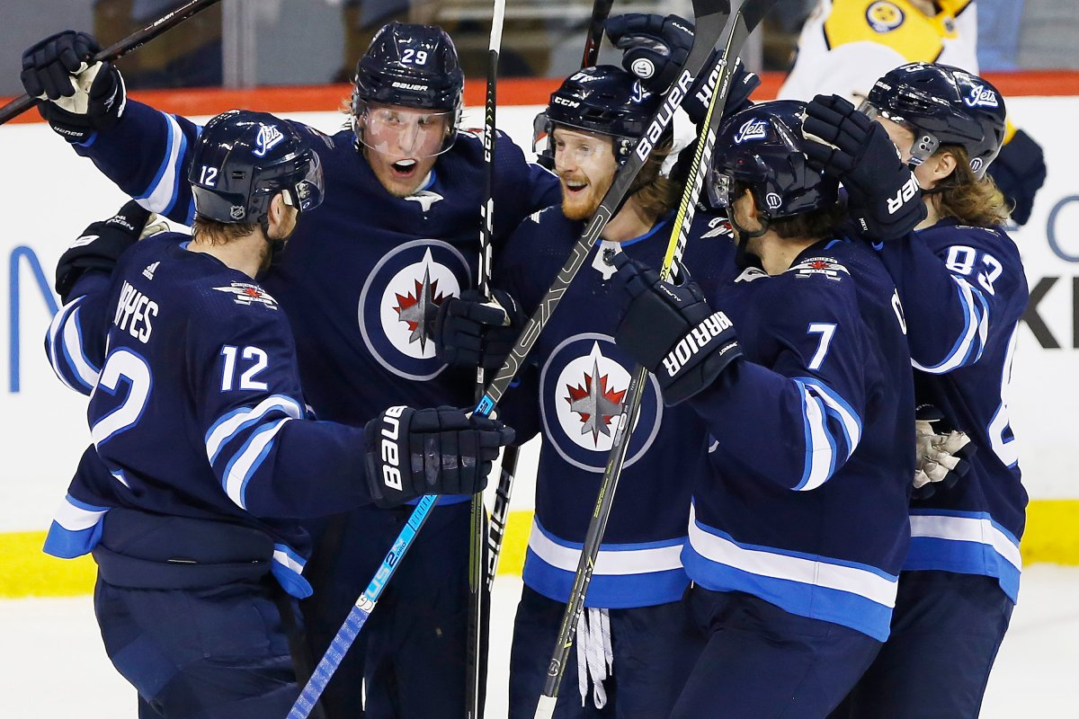 Winnipeg Jets' Kevin Hayes (12), Patrik Laine (29), Kyle Connor (81), Ben Chiarot (7) and Sami Niku (83) celebrate Connor's second goal of the game during third period NHL action against the Nashville Predators, in Winnipeg on Saturday, March 23, 2019. THE CANADIAN PRESS/John Woods.
