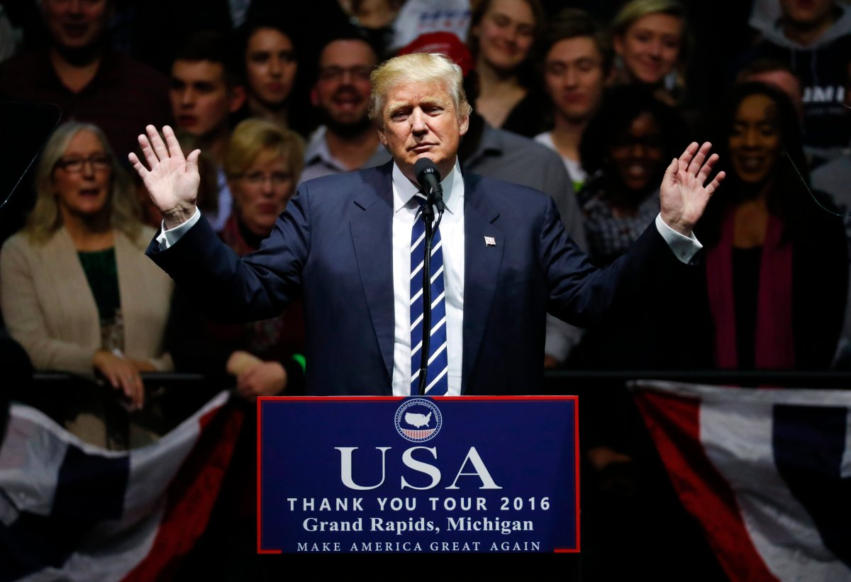 In this Dec. 9, 2016, file photo, President-elect Donald Trump speaks to supporters during a rally, in Grand Rapids, Mich.