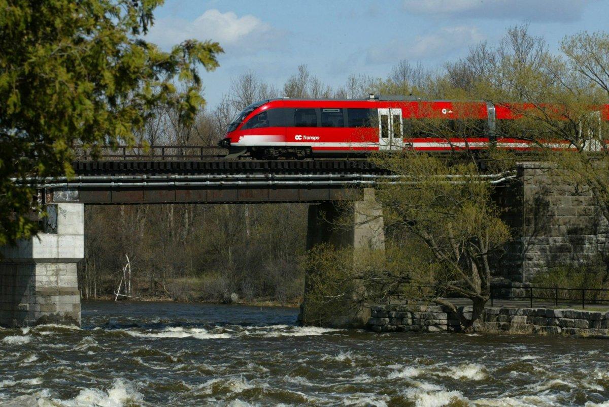The OC Transpo light rail train in Ottawa Friday, May 3, 2002 makes its way though Ottawa.