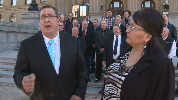 Dave Bjorkman (front left), Virginia Bruneau (front right) and other members of the Alberta Independence Party are pictured at a media event outside the Alberta legislature on March 20, 2019.