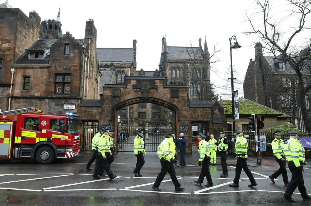 Police and fire services outside the University of Glasgow after the building was evacuated when a suspect package was found in the mailroom, in Glasgow, Scotland, Wednesday March 6, 2019.