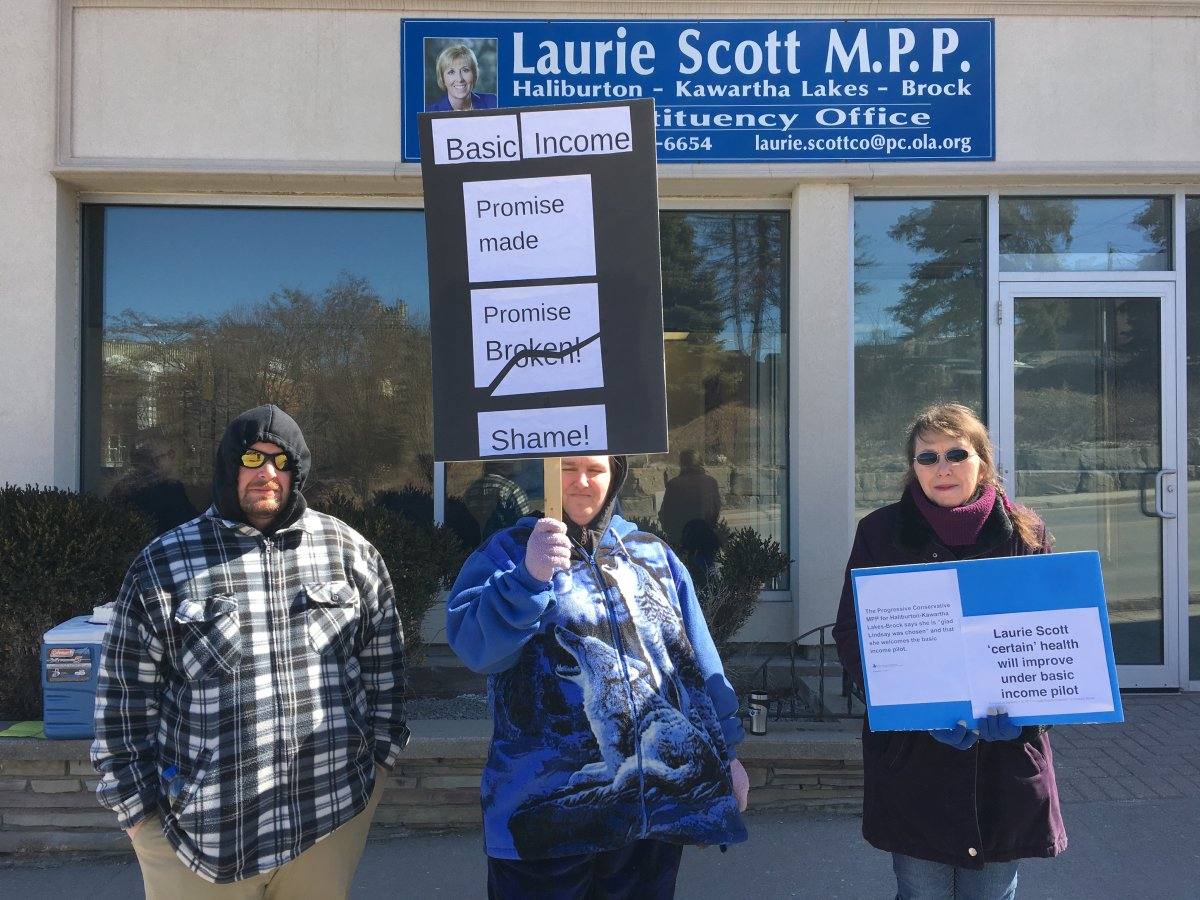 Protesters gather outside MPP Laurie Scott's office in Lindsay to express concerns about the province ending the basic income pilot project. Monday was the last day for the project.