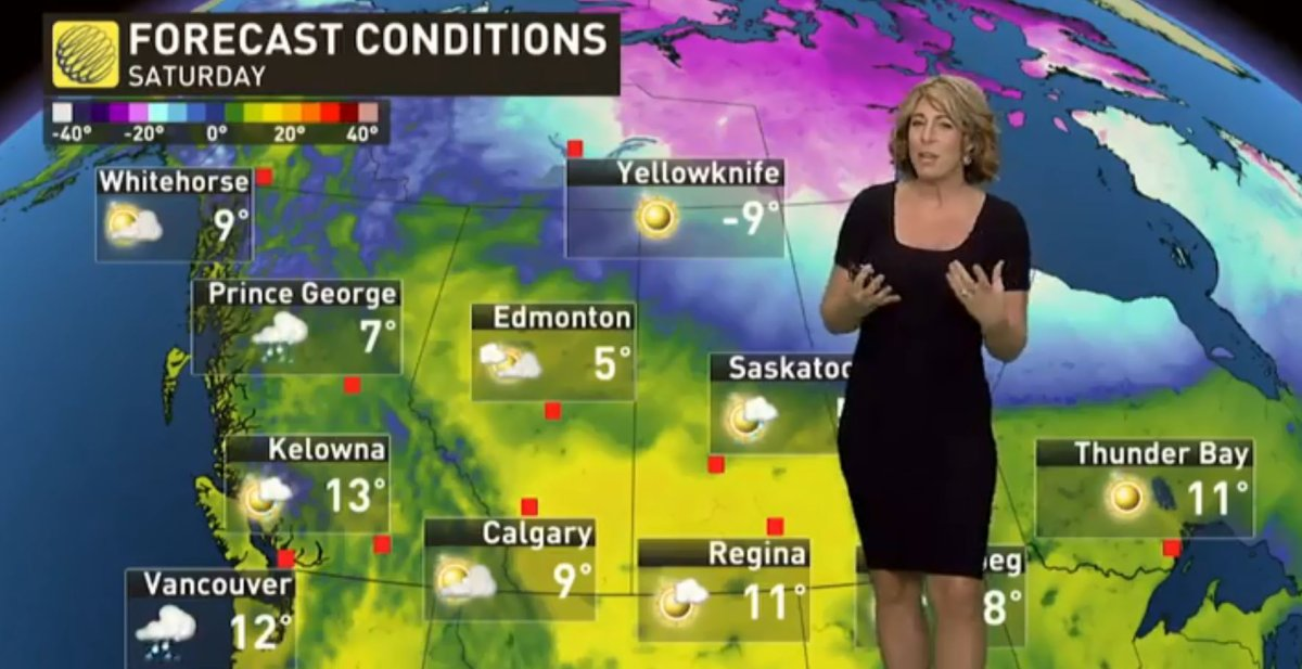 A Weather Network anchor standing in front of Manitoba on the map.