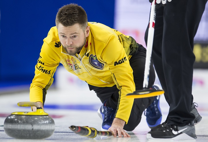 Team Manitoba skip Mike McEwen makes a shot during the 18th draw against team British Columbia at the Brier in Brandon, Man. Friday, March 8, 2019.