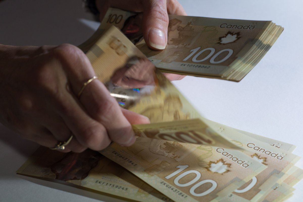 Canadian $100 bills are counted in Toronto, Feb. 2, 2016.