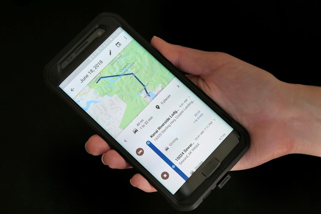In this Aug. 8, 2018, file photo, a mobile phone displays a user's travels using Google Maps in New York. Drivers using Google Maps are now getting a last-minute warning as they approach some photo radar camera locations.