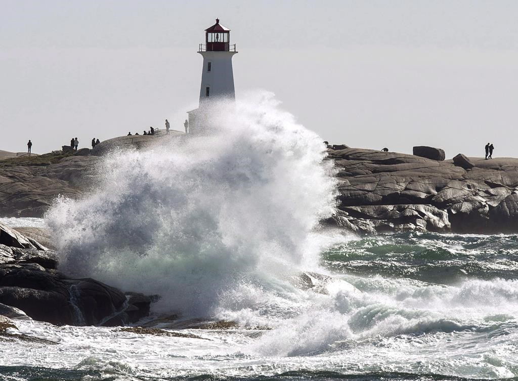 Waves hit the shore at Peggy's Cove, N.S. on Tuesday, Oct. 16, 2018 as high winds buffet the coast.