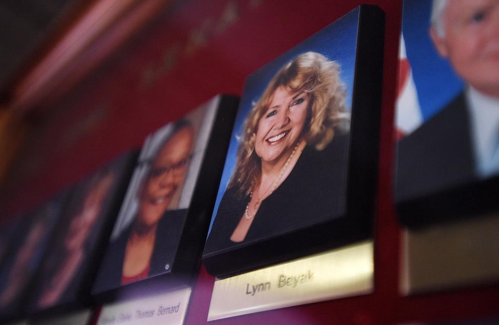 A picture of Senator Lynn Beyak accompanies other Senators official portraits on a display outside the Senate on Parliament Hill in Ottawa on Thursday, Sept. 21, 2017. The Senate's ethics officer says Sen. Lynn Beyak violated the upper chamber's conflict of interest code by posting racist letters about Indigenous Canadians on her website. THE CANADIAN PRESS/Sean Kilpatrick.
