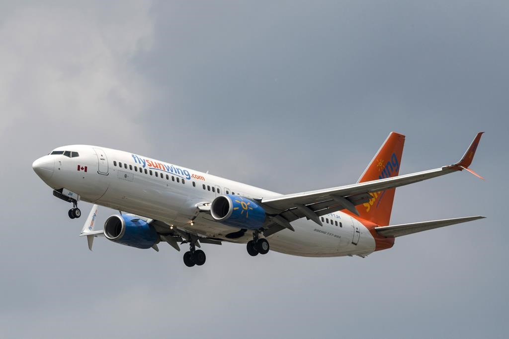 A Sunwing Boeing 737-800 passenger plane prepares to land at Pearson International Airport in Toronto on Wednesday, August 2, 2017.