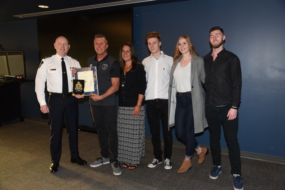 Karl Dey received the Award of Merit for helping police capture the suspects in two crimes.