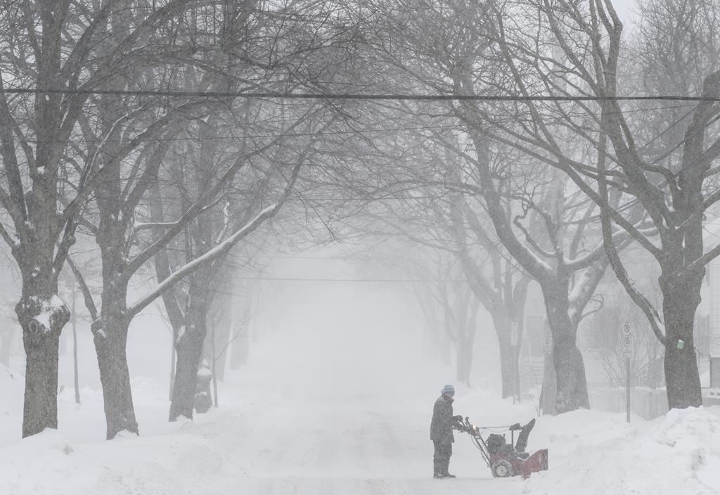 A man uses a snowblower to clear snow during a snowstorm in Halifax on Monday, March 4, 2019.
