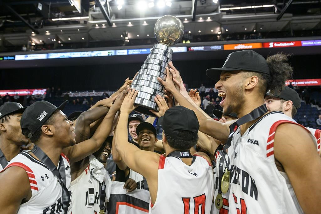 Members of the Carleton Ravens celebrate winning the USports men's basketball national championship over the University of Calgary Dinos in Halifax on Sunday, March 10, 2019.