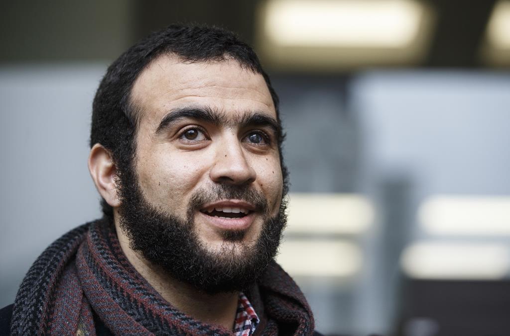 Former Guantanamo Bay prisoner Omar Khadr leaves court in Edmonton on Monday March 25, 2019.