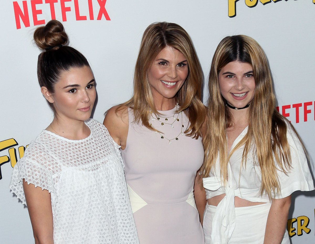 Actress Lori Loughlin (C) and daughters Isabella Giannulli (R) and Olivia Giannulli (L) attend the premiere of Netflix's 'Fuller House' at Pacific Theatres at The Grove on Feb. 16, 2016 in Los Angeles, California.