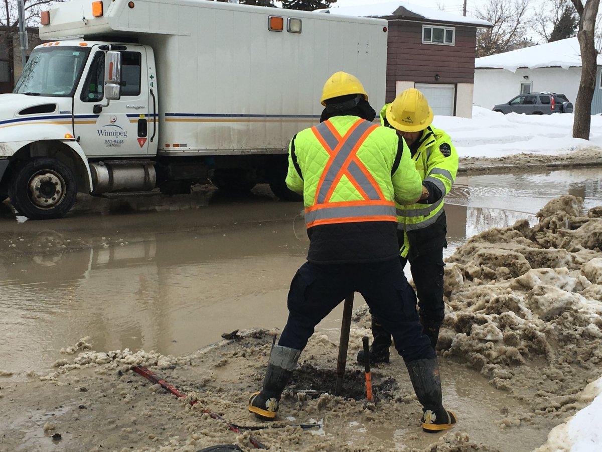 City of Winnipeg workers on Sinclair Street Friday.