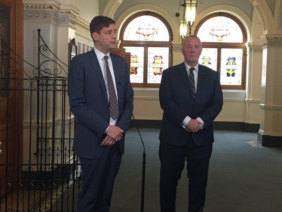 B.C. Attorney General David Eby and Minister of Border Security and Organized Crime Reduction Bill Blair speak to reporters in Victoria on March 27, 2019.
