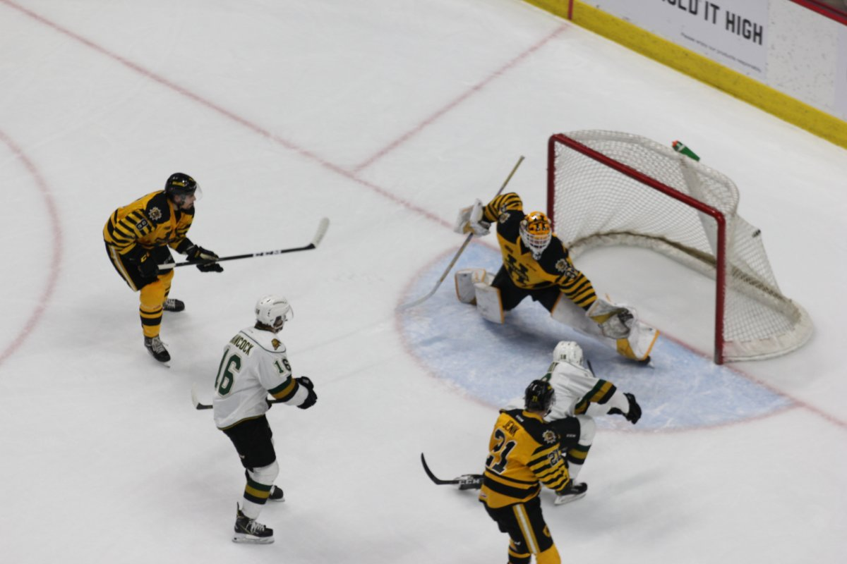 Hamilton, Ont. - Liam Foudy of the London Knights scores on Zachary Roy of the Hamilton Bulldogs in a 4-1 London win on March 2, 2019.